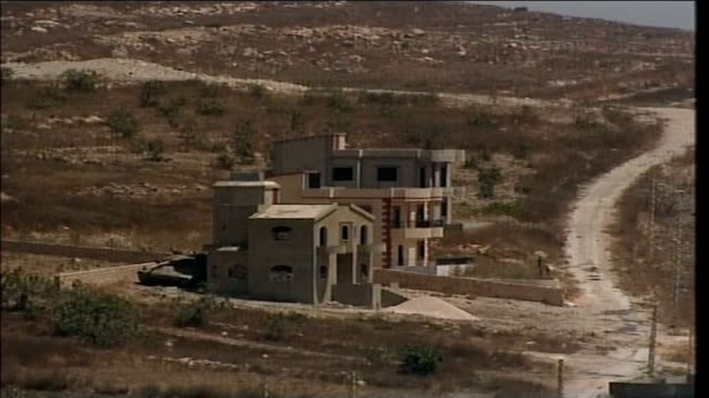 first day of ceasefire southern lebanon ext israeli army position showing tank behind a rural house - ceasefire stock videos and b-roll footage