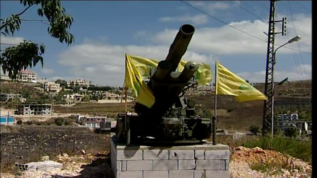 first day of ceasefire southern lebanon large artillery gun with hezbollah flags attached close shot hezbollah flag fluttering in wind - hezbollah stock videos & royalty-free footage