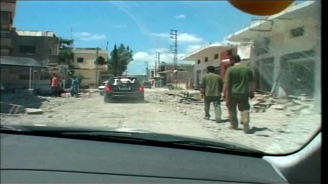 first day of ceasefire southern lebanon point of view from car of back view of hezbollah fighters walking along road / back view of hezbollah car... - ceasefire stock videos and b-roll footage