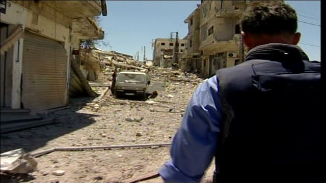 first day of ceasefire southern lebanon tracking shot as thomson walks along main street - ceasefire stock videos and b-roll footage