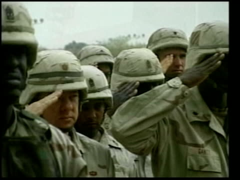 stockvideo's en b-roll-footage met gulf war trauma of returning troops pool howitzer firing cms us casualties helmets restingh on their upturned rifles track cms us soldiers saluting... - slachtoffer