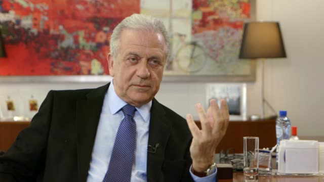 Human rights abuses revealed in refugee detention centres BELGIUM Brussels INT Dimitris Avramopoulos interview with reporter SOT