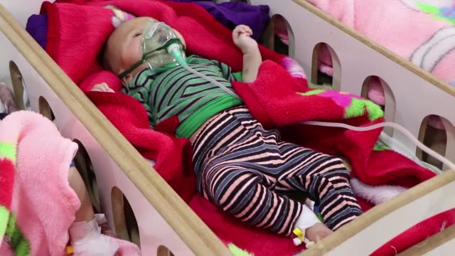 Hundreds of babies left abandoned and malnourished in hospitals after fall of ISIS caliphate SYRIA Various shots of babies lying in cots inside...