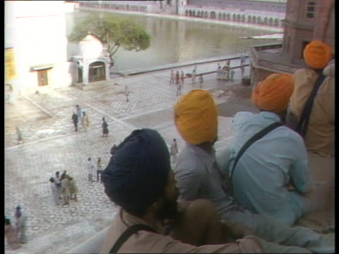 indian army advancing on jaffna r india punjab amritsar golden temple ms sandbags stacked on roof of building pull out sikh soldier standing guard... - sandbag stock videos & royalty-free footage