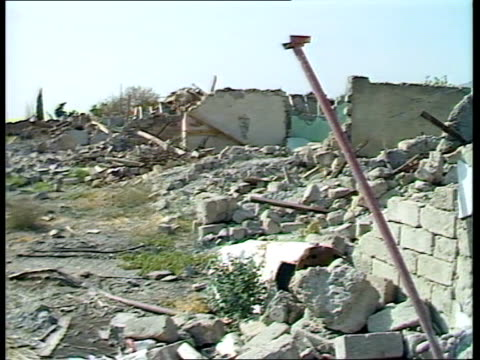 Iraqis condemned for using chemical weapons against Kurds N IRAQ Kurdistan Halabja EXT GV Ruins of devastastated houses piles of debris on ground PAN...