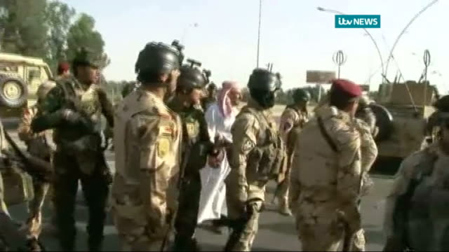 isis militants capture more towns and border crossings baghdad members of mahdi army gathered armoured vehicle along as soldiers watch end general... - isis stock videos and b-roll footage