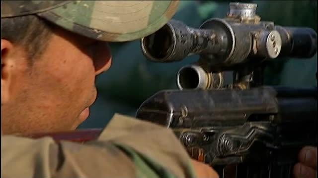 john kerry holds talks with kurdish leaders in irbil; iraqi kurdistan: ext various of kurdish army troops and tanks at sandbagged defensive line... - クルド人点の映像素材/bロール