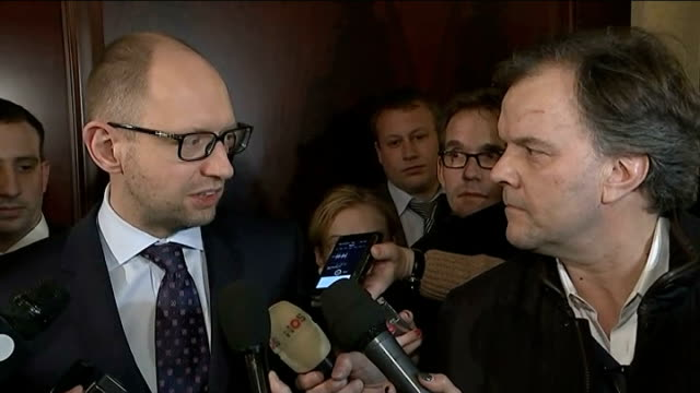 Kiev mobilises troops Arseniy Yatseniuk along in press scrum Arseniy Yatseniuk speaking to press SOT to contain Russian troops to contain Russia and...