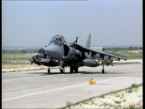 Kosovo NATO Bomb Bridge ITN ITALY Gioia del Colle Harrier taxiing towards along runway