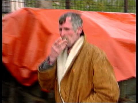 Kosovo Refugees ITN ALBANIA Kukes Old man helped by Yugoslav border guard to cross the border into Albania Border as Albainian police stand and watch...