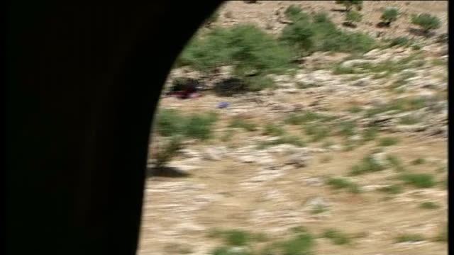 kurdish forces end siege of mount sinjar t11081406 yazifi refugees seen on mountainside after being forced from their homes by the advance of islamic... - isil conflict stock videos & royalty-free footage