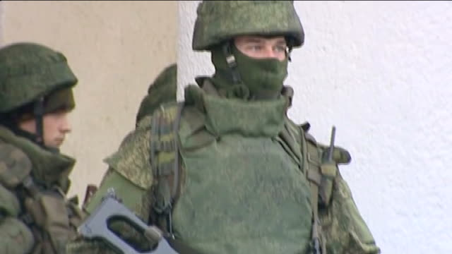 military build up in crimean peninsula / russia accused of 'armed invasion' ukraine crimea ext armed soldiers stand guard outside airport control... - ukraine stock videos & royalty-free footage
