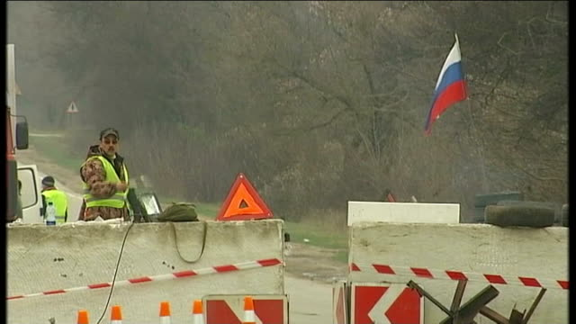 military build up in crimean peninsula / russia accused of 'armed invasion' simferopol russian flag at road block cars along through road block with... - ukraine stock videos & royalty-free footage