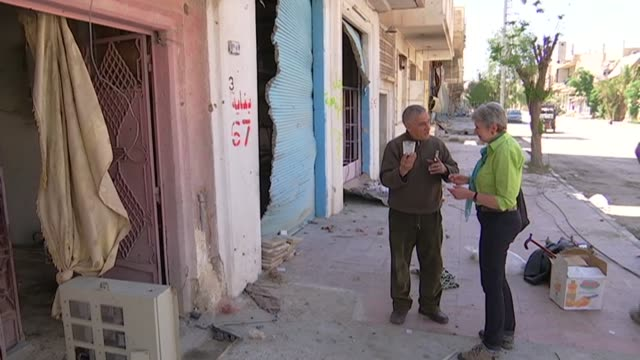 modern city of Palmyra devastation Interview Syrian man who speaks English returning home to ruined house after working in Russia SOT Along through...