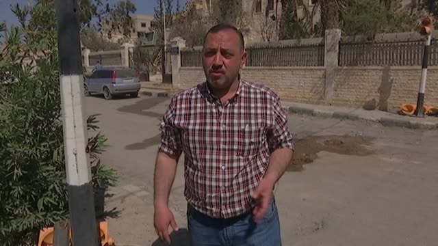 modern city of palmyra devastation mohammed al asaad speaking to reporter re father's killing sot father who was head of antiquities for the palmyra... - isil conflict stock videos & royalty-free footage