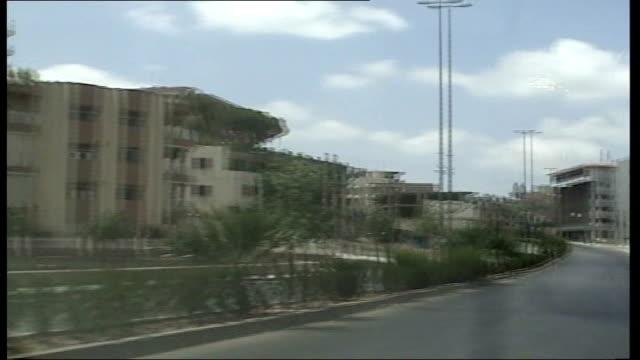 more violence as israeli forces cross border nabatiya pov of empty street track driver wearing helmet with manyon sitting in backseat - beifahrersitz oder rücksitz stock-videos und b-roll-filmmaterial