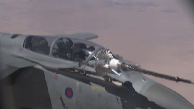 offensive to retake mosul from islamic state to begin soon cyprus raf akrotiri fighter plane in hangar close shot cockpit anonymous fighter pilot... - 給油点の映像素材/bロール