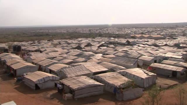 conflict ongoing war leads to mass rape disease and starvation south sudan int close shots malnourished children reporter in hospital chatting with... - スーダン点の映像素材/bロール