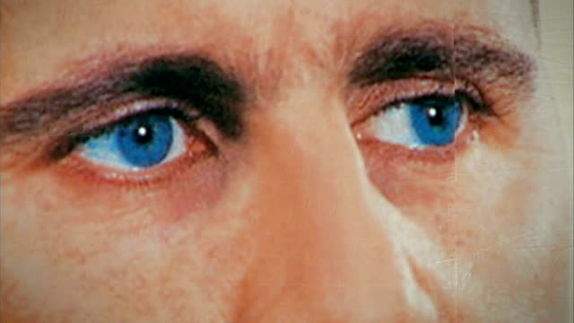 photographs allegedly show evidence of mass torture and killing of detainees; lib syria: ext close shot of eyes of bashar al assad on poster assad... - torture stock videos & royalty-free footage