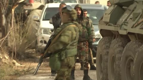 vidéos et rushes de pro-government forces retake key town of salma / russian troops at frontline; syria: latakia province: salma: ext russian military armoured truck... - ruiné