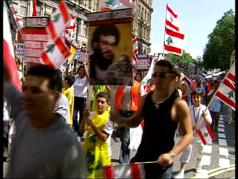 protest in london england london whitehall ext general view of mostly asian protestors marching on international day of action against israeli... - lebanese flag stock videos and b-roll footage