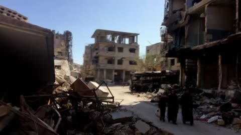 vidéos et rushes de rebel fighters evacuated from east ghouta; syria: eastern ghouta: ext wide shot city skyline with plume of smoke rising from explosion wide shot... - terrorisme