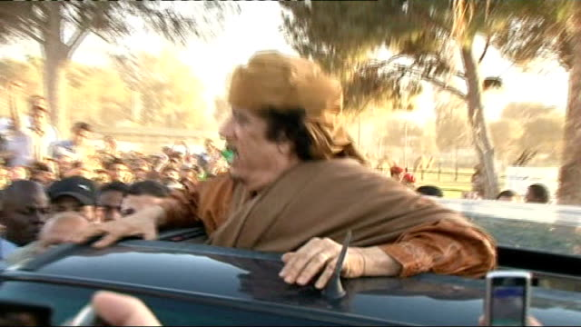 rebel forces take tripoli tx 1042011 bab alaziziyah compound gaddafi standing up in car as waves clenched fists to crowd of supporters end lib - muammar gaddafi stock videos & royalty-free footage