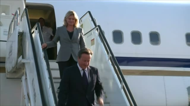 russia launches bombing raids jamaica kingston ext prime minister david cameron mp down steps from plane with justine greening mp david cameron mp... - isil conflict stock videos & royalty-free footage