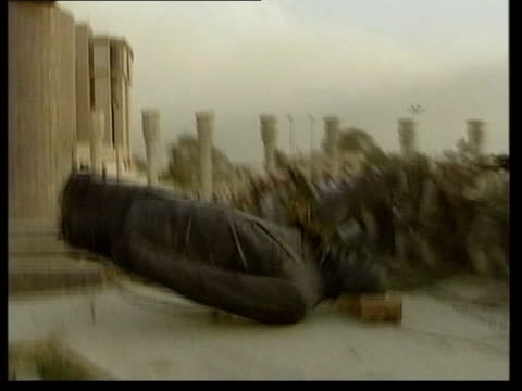 Saddam's hiding place/Last broadcast LIB Statue of Saddam being toppled and crowd surging forward