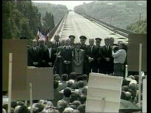 Serbia Cost of Rebuilding RTS YUGOSLAVIA Serbia Belgrade Serb President Slobodan Milosevic standing in front of bombed bridge destroyed by NATO bombs...