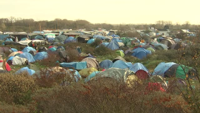 Seventh anniversary approaches refugee Ishmael's story FRANCE Calais EXT GVs 'Jungle' refugee camp/