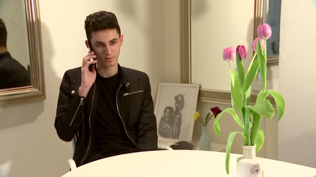 seventh anniversary approaches refugee ishmael's story england london int ishmael interview and setup attempting to call his parents in syria/ - ラゲ オマール点の映像素材/bロール