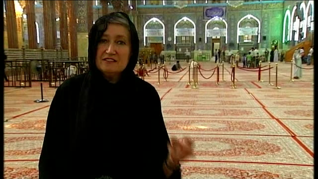 shia shrines in karbala under threat from isis militants religious men praying reporter to camera man reading book in mosque people along in mosque... - shrine stock videos & royalty-free footage