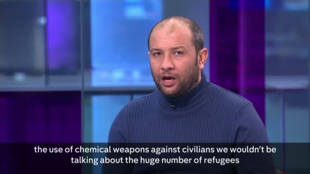 syrian and russian airstrikes reportedly kill ten turkish soldiers in idlib england london gir int raad al saleh studio interview sot - キャシー・ニューマン点の映像素材/bロール