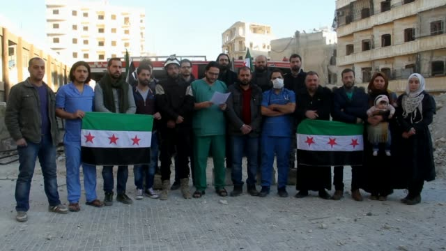 Syrian forces and their allies advance into eastern Aleppo Doctor reading out written statement to camera surrounded by others holding Syrian flags...