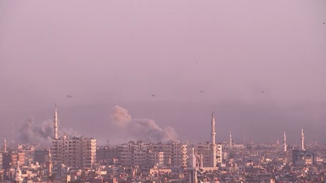 syrian forces intensify bombardment of remaining antiassad enclave of yarmouk syria damascus yarmouk ext long shots of yarmouk district skyline as... - bombing stock videos & royalty-free footage