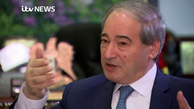 Syrian Foreign Minister accuses Britain of faking chemical attack SYRIA Damascus INT Faisal Mekdad set up shot / interview SOT