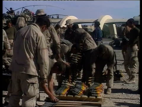 taliban hunt; itn afghanistan: kandahar ext us truck on airbase as soldier away in b/g us marines preparing weapons on ground soldier dusting weapon... - kabul stock videos & royalty-free footage