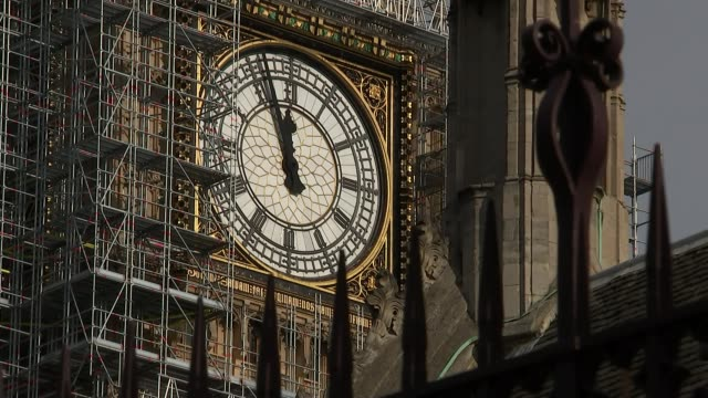 Theresa May to trigger emergency Commons debate on military action R301017008 / Westminster Houses of Parliament EXT Big Ben clock face surrounded by...