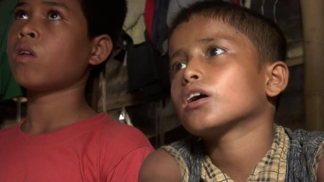 thousands of rohingya children suffering in refugee camps bangladesh kutupalong refugee camp int jaane alam interview sot then i got into a boat with... - hands behind head stock videos & royalty-free footage