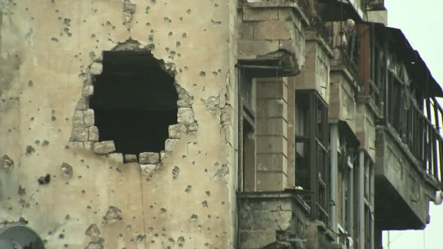 UN condemns both sides in Syrian Civil War for targeting hospitals and civilians TX Aleppo EXT Various of bombdamaged and destroyed buildings Spent...