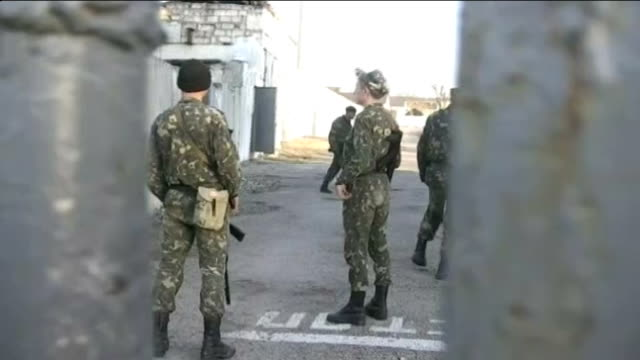 us and eu consider sanctions as russia takes control of crimea people gathered outside port building reporter to camera various shots of ukrainian... - military training stock videos & royalty-free footage