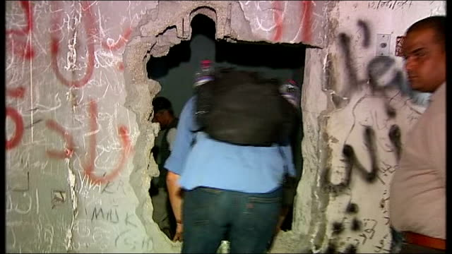 vast underground complex found under colonel gaddafi's compound libya tripoli ext libyan man climbing out of tunnel hatch and jokingly saying 'hello... - remote controlled stock videos and b-roll footage