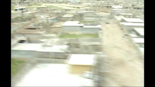 'video evidence' of chemical weapons use; t22038804 / tx 22.3.1988 iran / iraq border: halabja: ext/day air view / aerial over kurdish town following... - iraq video stock e b–roll