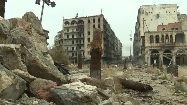 Western Aleppo general views / Great Mosque of Aleppo damage SYRIA Aleppo Western Aleppo EXT Burnt out tank / various of buildings destroyed by...