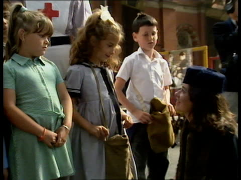 evacuated children reunited; england, london jazz band playing as balloons decorate platform sof tgv former evacuees gathered on platform for reunion... - 1930 1939点の映像素材/bロール