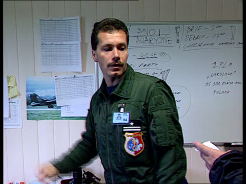 vidéos et rushes de summit; itn norway two nato f16s along runway and take off r-l int raf officer at wall map as briefing polish counterparts sot two polish officers... - british military