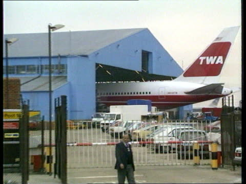 nuclear weapons capability lap ext ms twa 747 half in and half out of hanger pull out cms nuclear trigger that was seized en route for iraq being held - twa video stock e b–roll