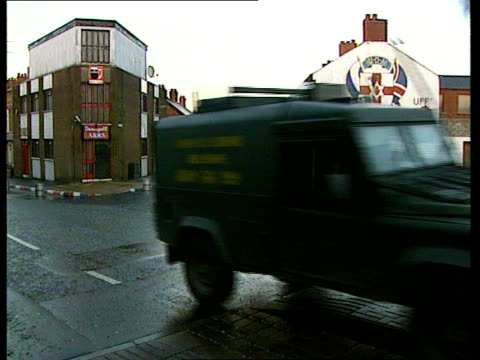 Conflict/Politics Upsurge in Violence ITN NORTHERN IRELAND Belfast EXT Police officers and soldiers manning vehicle checkpoint on street stopping...