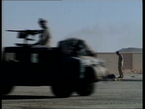 marines search for mullah omar; 12.20: u'lay pool ex server afghanistan: kandahar airport: ext us marine manning gun atop truck as along at airport... - kandahar stock-videos und b-roll-filmmaterial